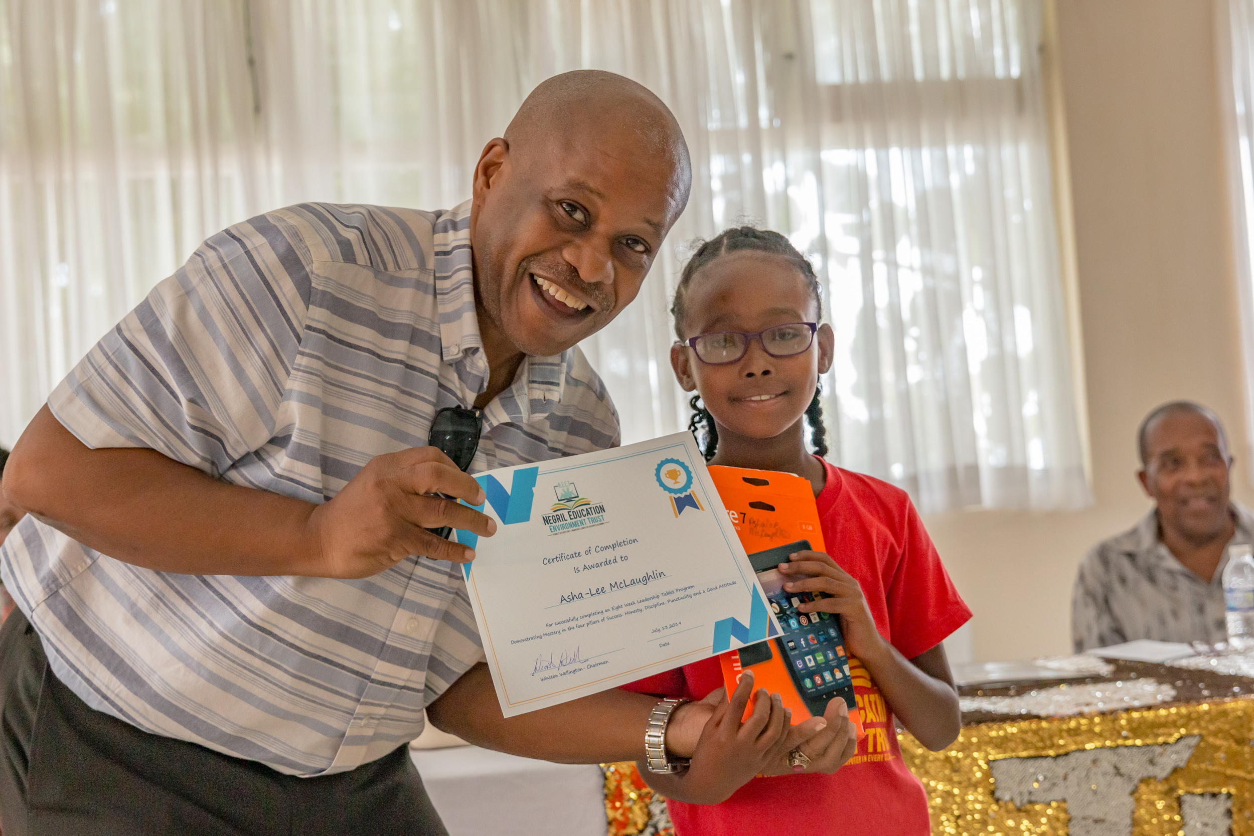 Student Receives certificate and Tablet