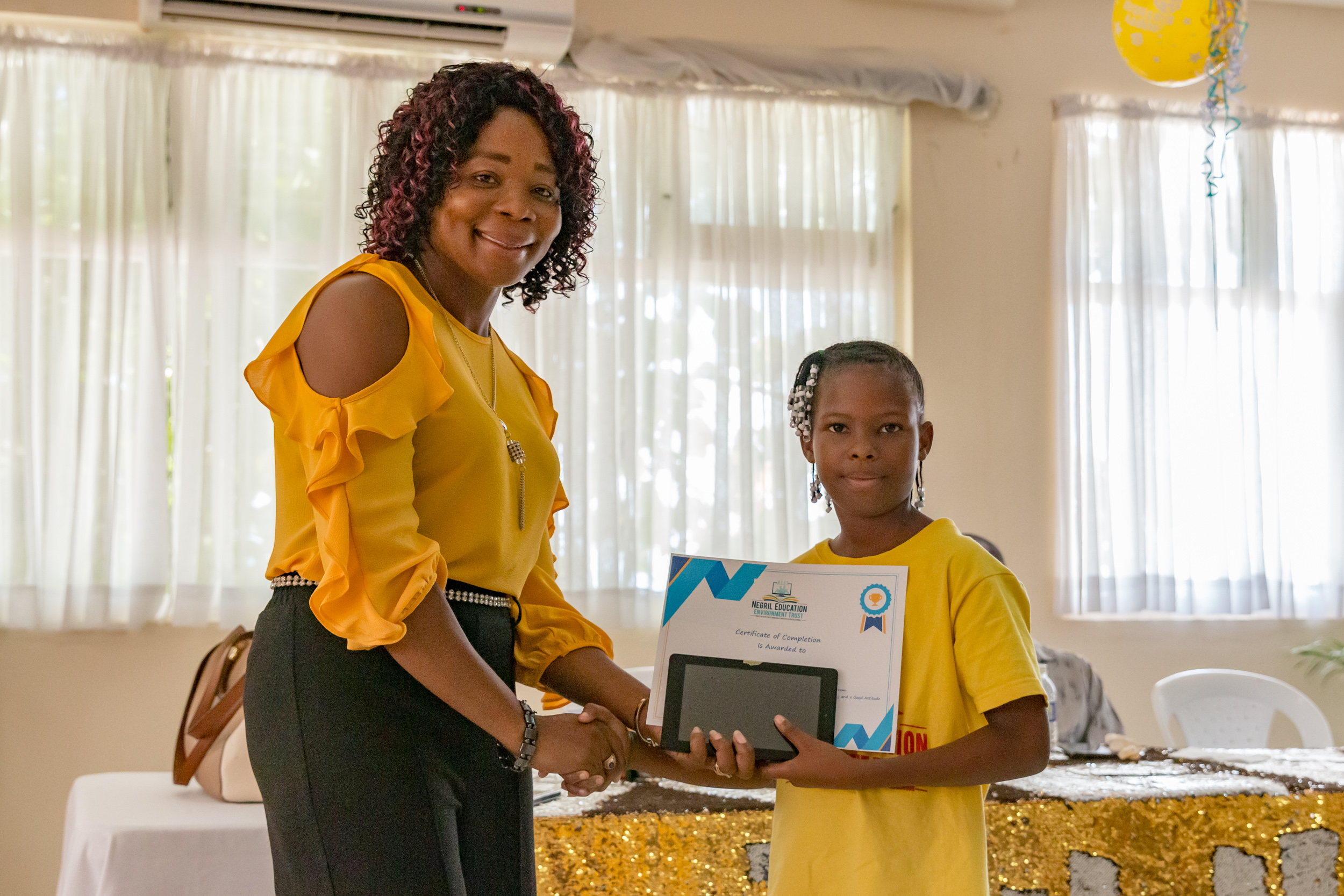 Student receives plaque and tablet