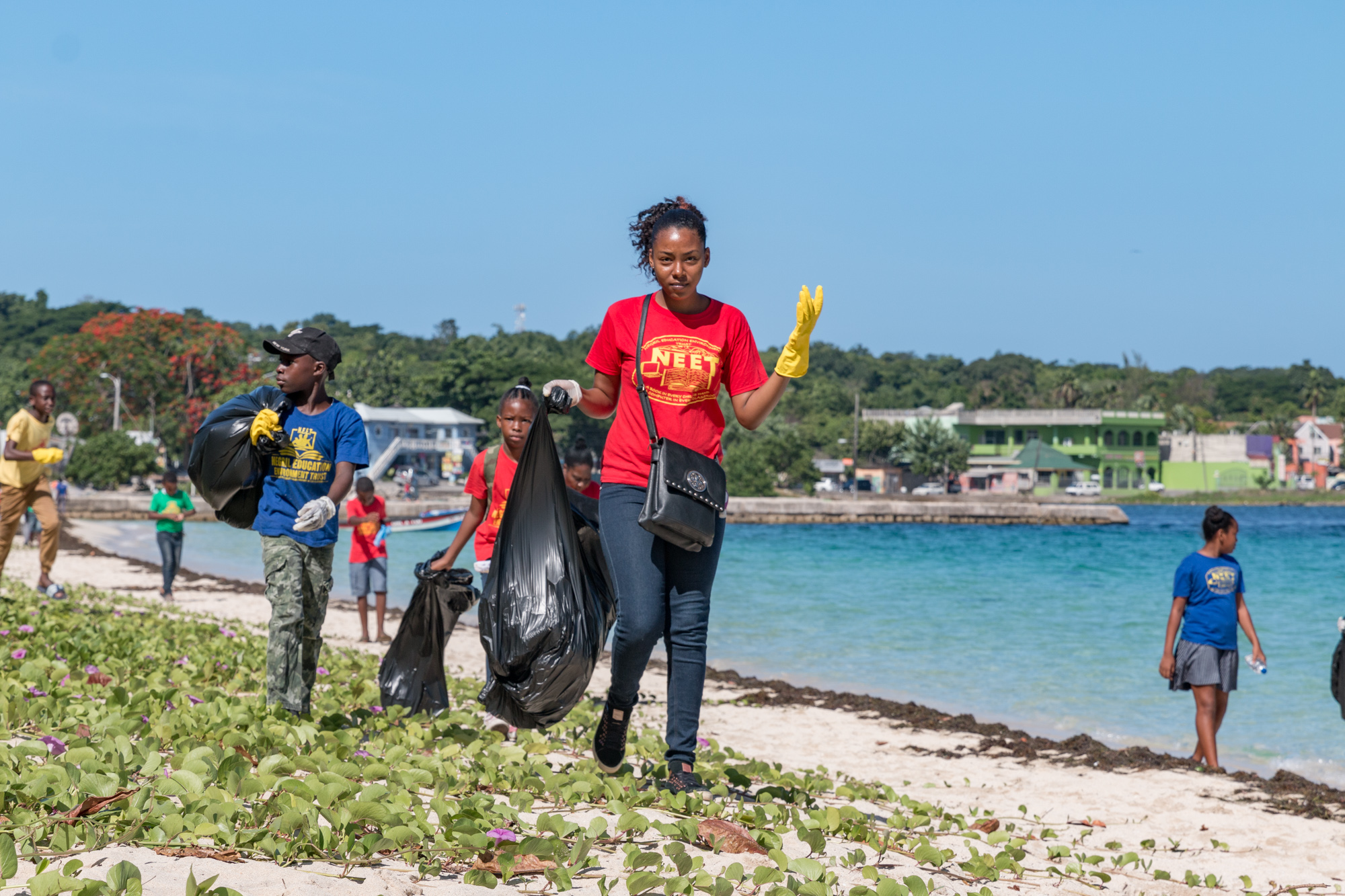 Volunteers with bags of garbage