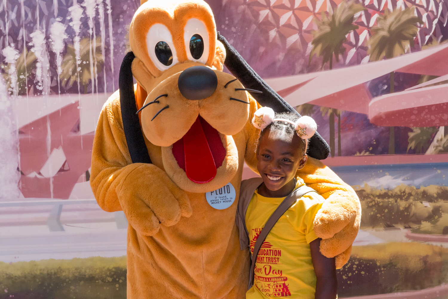 Student poses with Goofy